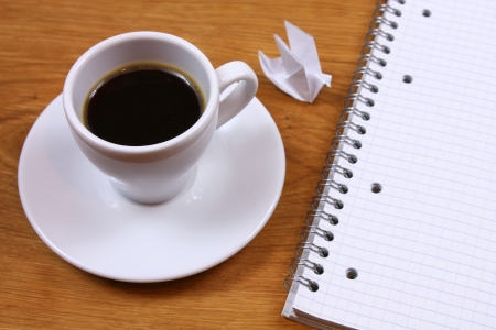Morning coffee inspiration. Origami dove and note pad Stock Photo - 14609642