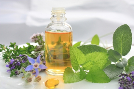 inhalation: Fresh herbs and oil. Natural medicine Stock Photo
