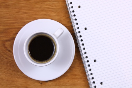 Espresso coffee and paper notebook photo
