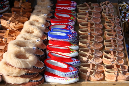 Traditional polish leather mountain boots for children called kierpce on outdoor market