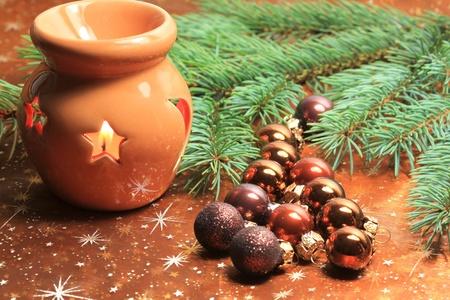 Christmas table decoration, lantern and fresh fir photo