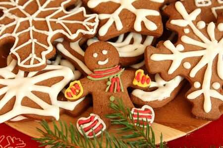 Gingerbread man and cookies - close up photo