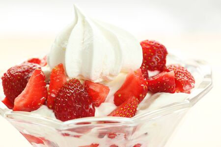 Close up of delicious strawberries with cream and meringue. Eton mess dessert Stock Photo