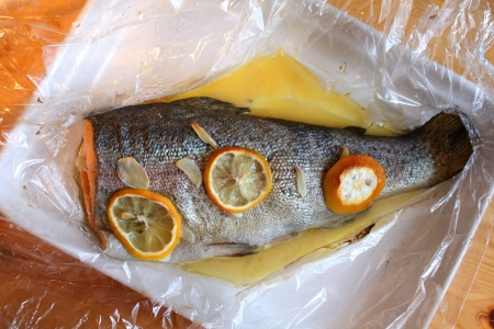 heatproof: Rainbow trout baked with garlic and lemon in foil. Healthy food Stock Photo