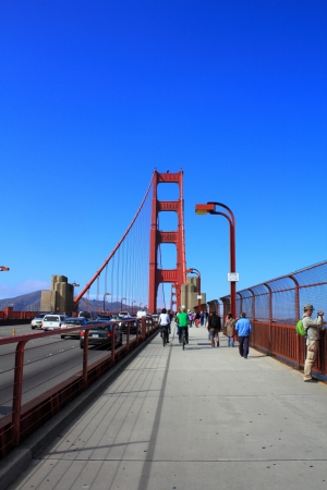 sightseeng: SAN FRANCISCO, United States of America - SEPTEMBER 13 : Tourists walking through Golden Gate bridge on September 13, 2012 in San Francisco, California, USA. Golden Gate bridge is the most recognized symbol of San Francisco