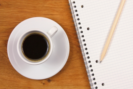 Coffee and notebook - top view photo