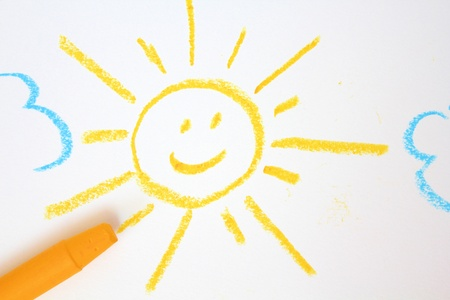 Cute childish drawing by wax crayons. Sun and clouds photo