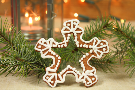 Snowflake - gingerbread cookie and fir branch. Christmas table decoration photo