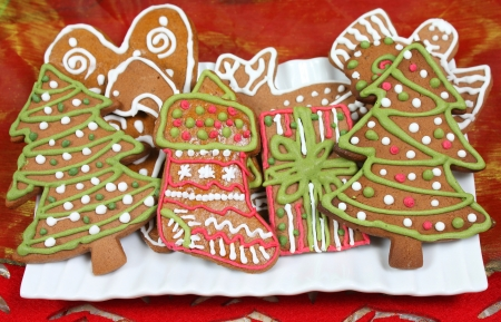 Christmas gingerbread cookies shapes: trees, present and stocking photo