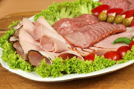 cold cuts: Party banquet plate with cold cuts of polish ham and sausage. Traditional polish smoked meat  Stock Photo