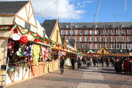 MADRID, SPAIN - DECEMBER 4 : People buy at the Christmas market stalls on Plaza Mayor on December 4, 2012 in Madrid Spain. Grand Christmas Market is a popular attraction for tourists and locals