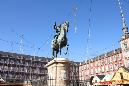 Plaza Mayor in Madrid, Spain with statue of Philip III. Christmas decorations and market