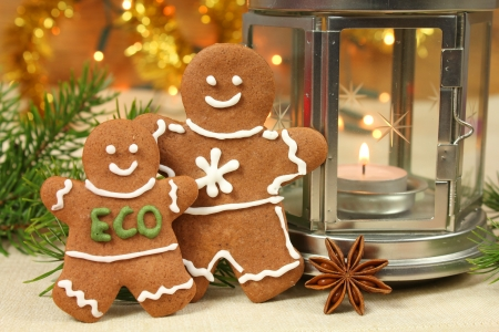 Christmas gingerbread people with ecological message. Decoration of table photo