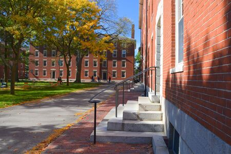 harvard: CAMBRIDGE, USA - OCTOBER 20, 2014: Harvard University yard. Harvard is the most prestigious and  oldest university in United States