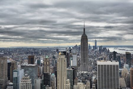 cloudy day: NEW YORK CITY, USA - OCTOBER 24, 2014: Manhattan Midtown skyline on cloudy day. New York City is the cultural and financial capital of the world