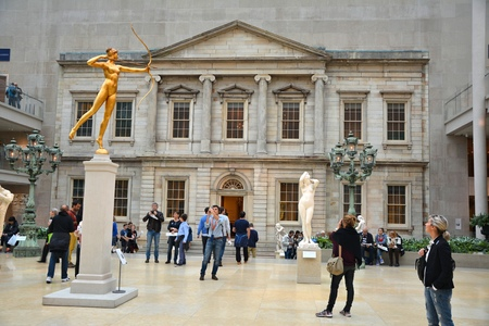 art museum: NEW YORK CITY - OCTOBER 22, 2014: People visit Metropolitan Museum of Art. Sculpture of Diana inThe Charles Engelhard Court in American Wing