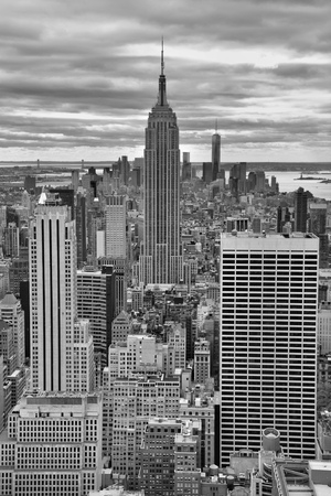 stature: NEW YORK CITY, USA - OCTOBER 24, 2014: Manhattan Midtown skyline on cloudy day. New York City is the cultural and financial capital of the world