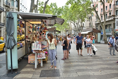 rambla: BARCELONA, SPAIN - AUGUST 08, 2014: People walk La Rambla street. La Rambla is popular tourist destination in Barcelona Editorial