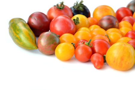 heirloom: Heirloom colorful tomatoes on white background Stock Photo