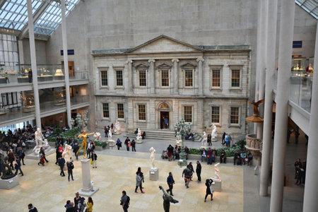museum visit: NEW YORK CITY - OCTOBER 22, 2014: People visit Metropolitan Museum of Art.The Charles Engelhard Court in American Wing Editorial