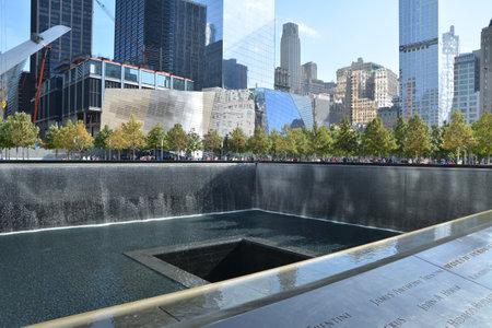 NEW YORK CITY - OCTOBER 14, 2014: National September 11 Memorial at Ground Zero Editorial