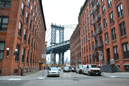 manhattan bridge: NEW YORK CITY - OCTOBER 15, 2014: Manhattan bridge view from Brooklyn Dumbo neighborhood. Manhattan Bridge connects boroughs of Manhattan and Brooklyn over East River