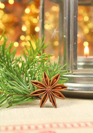 homelike: Christmas decoration: fresh fir branch, star anise and lantern Stock Photo