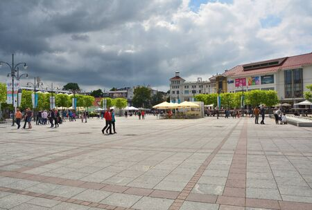 seaside resort: SOPOT, POLAND - JUNE 25, 2015: People walk on Plac Zdrojowy market square in city center. Sopot is a major spa and tourist seaside resort in Poland Editorial