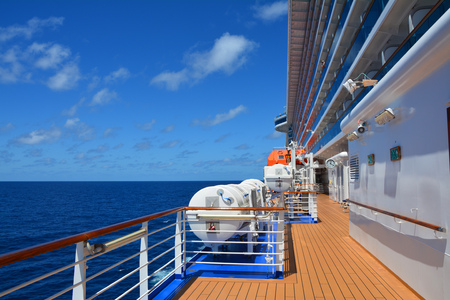 Open deck on huge cruise ship sailing on the Caribbean sea Stock Photo