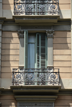 decorative balconies: Window and balcony. Facade of the building in Barcelona Stock Photo