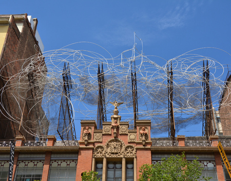 BARCELONA, SPAIN - AUGUST 9, 2015 : Sculpture of Antoni Tapies on the top of the Fundacio Antoni Tapies building. The museum is located in Carrer dArago