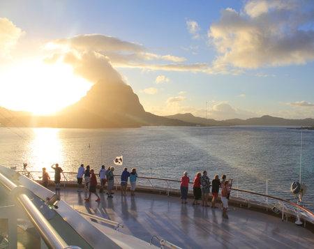 borabora: BORA BORA, FRENCH POLYNESIA - SEPTEMBER 28, 2012 : Cruise ship passengers watch the sunrise over Bora Bora island
