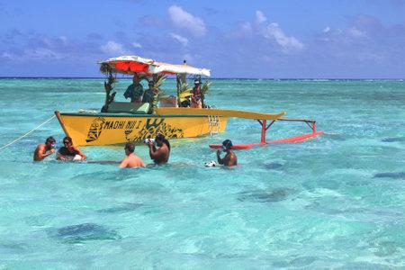 stingrays: BORA BORA, FRENCH POLYNESIA - SEPTEMBER 28, 2012 : People snorkel and play with stingrays and sharks. Stingray feeding is a popular attraction in Bora Bora Editorial
