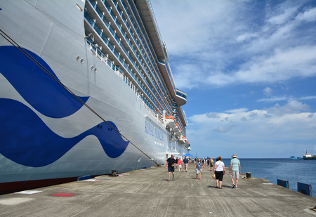 GRENADA, CARIBBEAN - MARCH 25, 2017 : Passengers from Royal Princess ship leave the vessel in Saint George port. Royal Princess is operated by Princess Cruises line and has a capacity of 3600 passengers