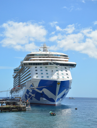 DOMINICA, CARIBBEAN - MARCH 24, 2017 : Royal Princess ship docked in Roseau port. Royal Princess is operated by Princess Cruises line and has a capacity of 3600 passengers Editorial