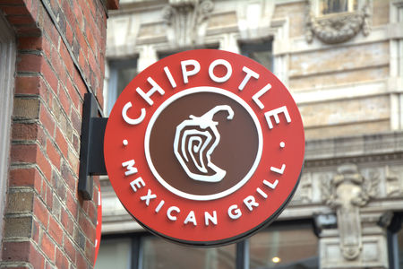 BOSTON, USA - OCTOBER 21, 2014 :  Chipotle Mexican Grill signboard on the wall in Boston. Chipotle is a chain of American restaurants serving mexican food
