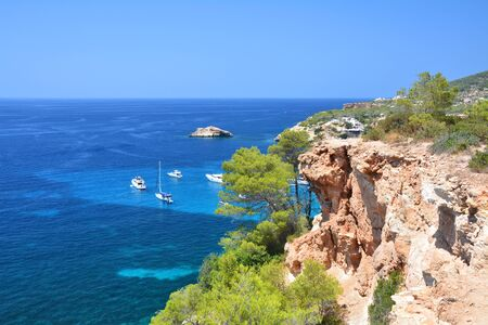 vedra: Scenic view from the cliff on turquise Balearic sea. Cala dHort, Ibiza island