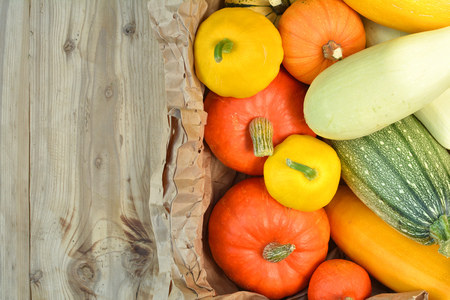 Fresh pumpkins and squash harvest. Autumn wooden background Stock Photo