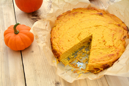 Homemade pumpkin cheesecake on wooden table