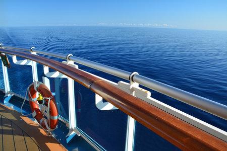 CUBA, CARIBBEAN SEA - MARCH 28, 2017 : Stern of Royal Princess ship with lifebuoy on the railing. Royal Princess is a passenger ship operated by Princess Cruises line.