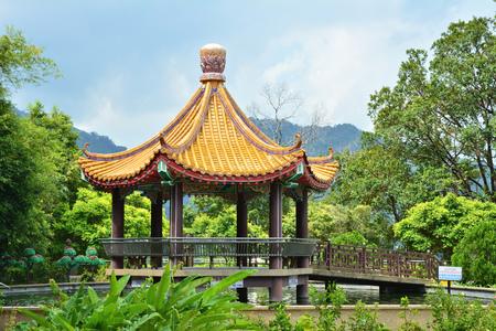 Pavilion over pond in Kek Lok Si temple garden on Penang island, Malaysia.