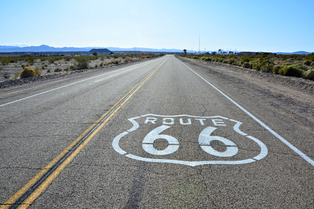 Route 66 sign on the road in Amboy, California.