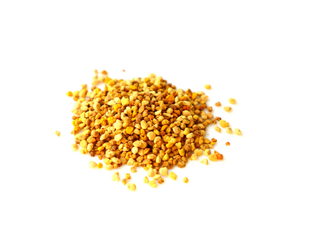 Bee pollen grains on white background. Superfood