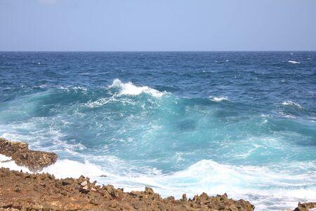 Big wave on Caribbean sea by the rocky coast of Aruba island, Dutch Caribbean