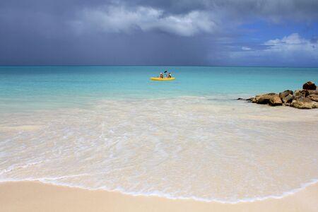 Paradise beach in Antigua island, Caribbean Sea wave. Imagens