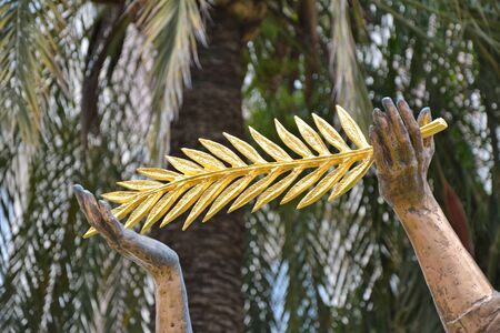 The angel sculpture with golden palm in Cannes, France, Cote d'Azur.