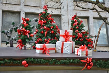 Christmas market decoration in Munich, Germany. Christmas trees and presents. Banco de Imagens