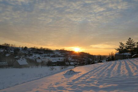 Sunset winter snow landscape in the village in Poland. Banco de Imagens