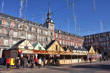 MADRID, SPAIN - DECEMBER 4 : Christmas market stalls on Plaza Mayor  in Madrid Spain. Grand Christmas Market is a popular attraction for tourists and locals in December Editorial