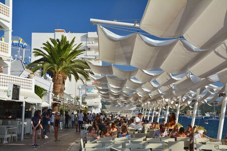 IBIZA, SPAIN - JULY 12, 2017: Cafe Mambo in San Antonio de Portmany on Ibiza island. It is a famous seaside bar with the best views of sunset with live dj chillout music